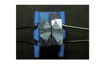 7B04 铝合金锻件探伤缺陷分析